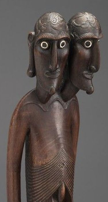 Double headed easter island wood sculpture